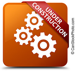 Under construction (gears icon) brown square button red ribbon in corner