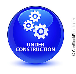 Under construction (gears icon) glassy blue round button