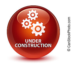 Under construction (gears icon) glassy brown round button