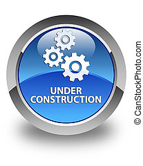 Under construction (gears icon) glossy blue round button