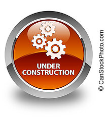 Under construction (gears icon) glossy brown round button