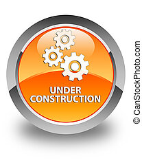 Under construction (gears icon) glossy orange round button