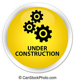 Under construction (gears icon) premium yellow round button