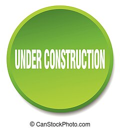 under construction green round flat isolated push button