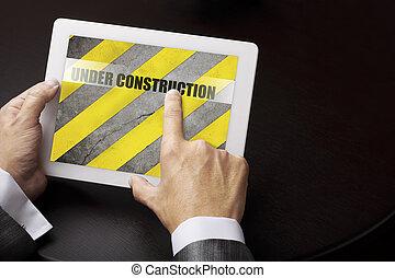 Under construction (internet concept) - adult using digital...