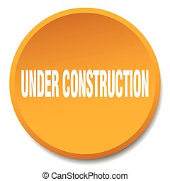 under construction orange round flat isolated push button