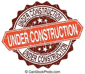 under construction orange round grunge stamp on white