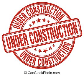 under construction red grunge round vintage rubber stamp