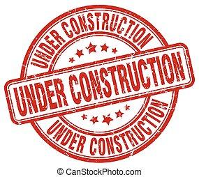 under construction red grunge round vintage rubber stamp