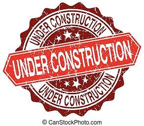 under construction red round grunge stamp on white