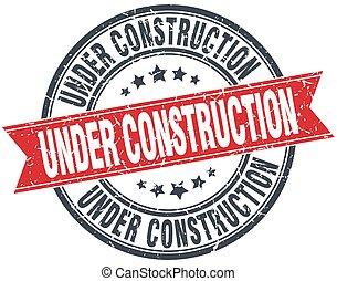 under construction red round grunge vintage ribbon stamp