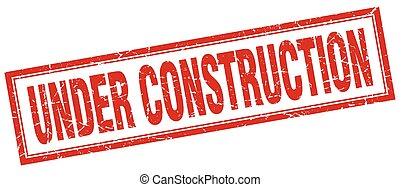 under construction red square grunge stamp on white