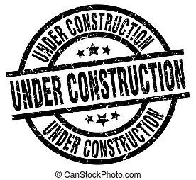under construction round grunge black stamp