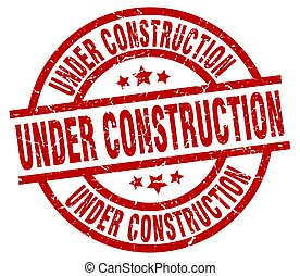 under construction round red grunge stamp
