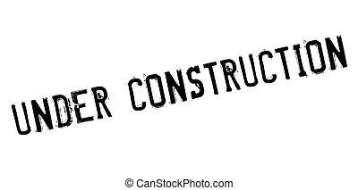 Under construction rubber stamp. Grunge design with dust...