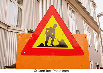 Under construction sign in a street