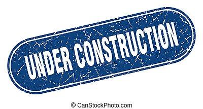 under construction sign. under construction grunge blue stamp. Label
