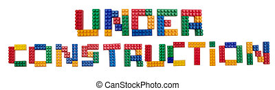 Under construction colorful letters on white background