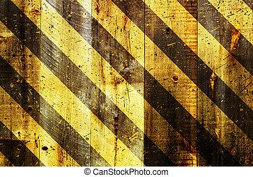 under construction strips on wooden background