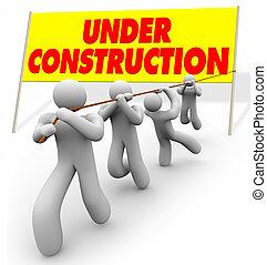 Under Construction - Team Pulling Up Sign
