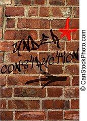 Under Construction - Under construction grafitti on brick...
