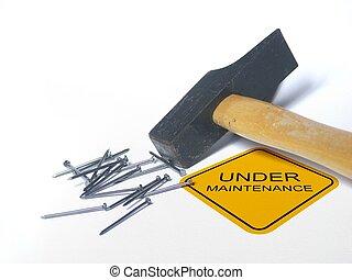 Under maintenance - hamer with under maintenance sign for...