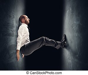 Under pressure - Concept of a stressed businessman under...