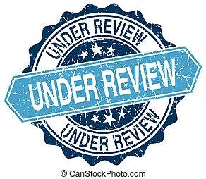 under review blue round grunge stamp on white