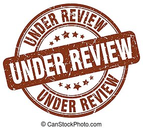 under review brown grunge round vintage rubber stamp