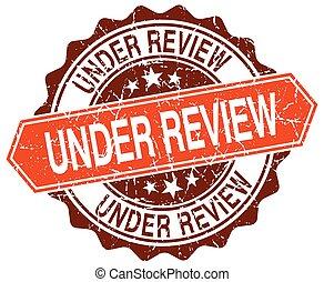 under review orange round grunge stamp on white