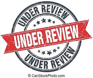 under review red round grunge vintage ribbon stamp