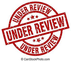 under review round red grunge stamp