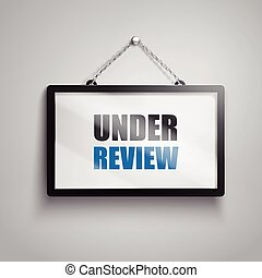 under review text sign