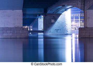 Under the Alexander Nevsky Bridge across the Neva River in Saint Petersburg, Russia in the evening or night