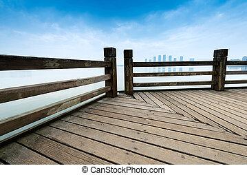 Under the blue sky, platform beside sea