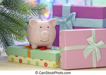 Under the Christmas tree are boxes with gifts. On the box is a small pig piggy bank.