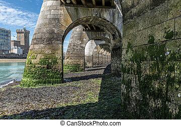 Under the footbridge at low tide
