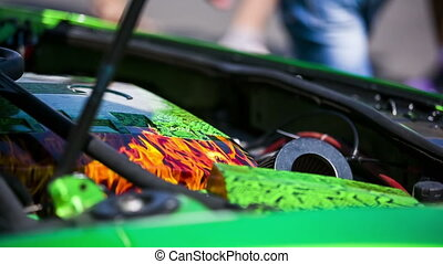 Under the Hood of a Green Sportive Car