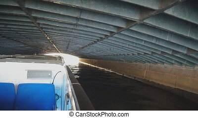 Under the longest bridge of the river Moyka in St. Petersburg. Blue bridge.