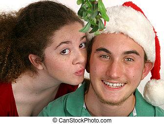 Under The Mistletoe - A teenaged girl kissing a teenaged boy...