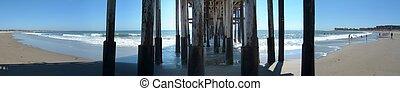 Under The Pier - View of pacific ocean in Ventura under the...