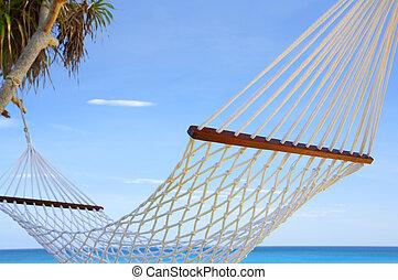 under the sky - view of nice white hammock hanging between...