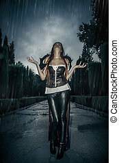 Under the storm, Beautiful vampire woman in palace gate, gothic fantasy huge coat