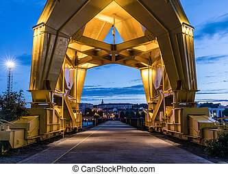 Under the yellow crane by nigh - Under the gigantic yellow...