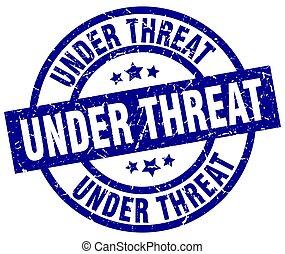 under threat blue round grunge stamp