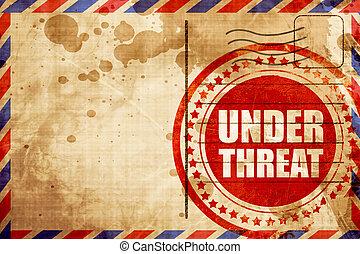under threat, red grunge stamp on an airmail background -...