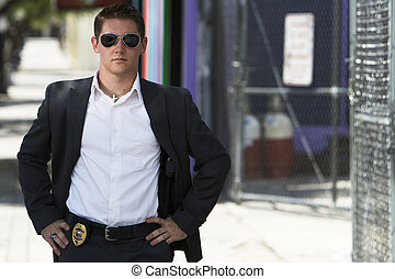 Undercover Officer in a suit - Undercover officer dressed in...