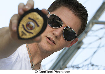 Undercover officer with badge - Male undercover police...