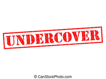 UNDERCOVER red Rubber Stamp over a wite background.