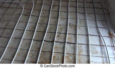 Underfloor heating system tubes on the floor before concrete...